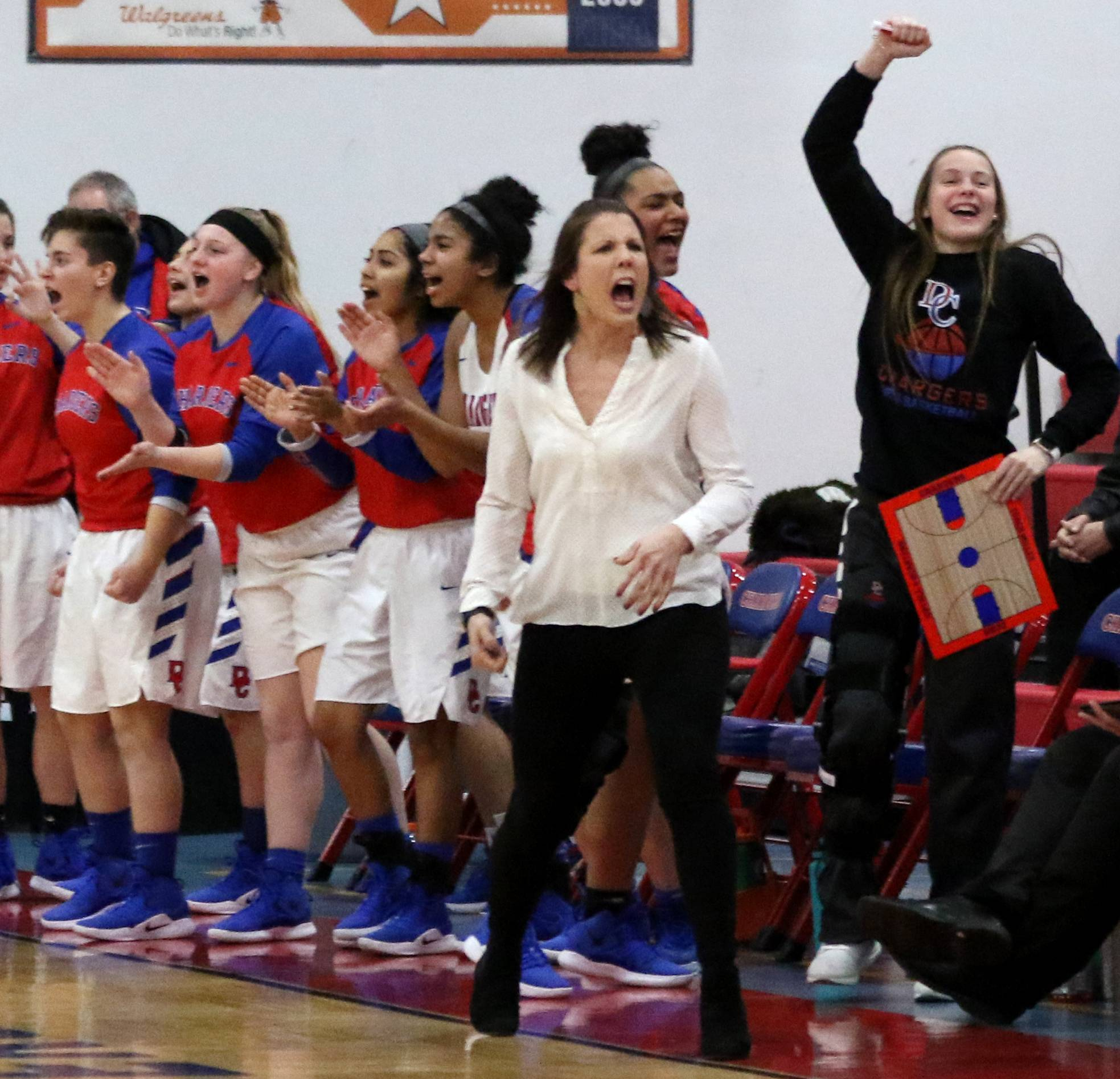 Patrick Kunzer/pkunzer@dailyherald.comDundee-Crown head coach Sarah Miller and the Chargers cheer during varsity girls basketball against Hampshire at Carpentersville Friday night.