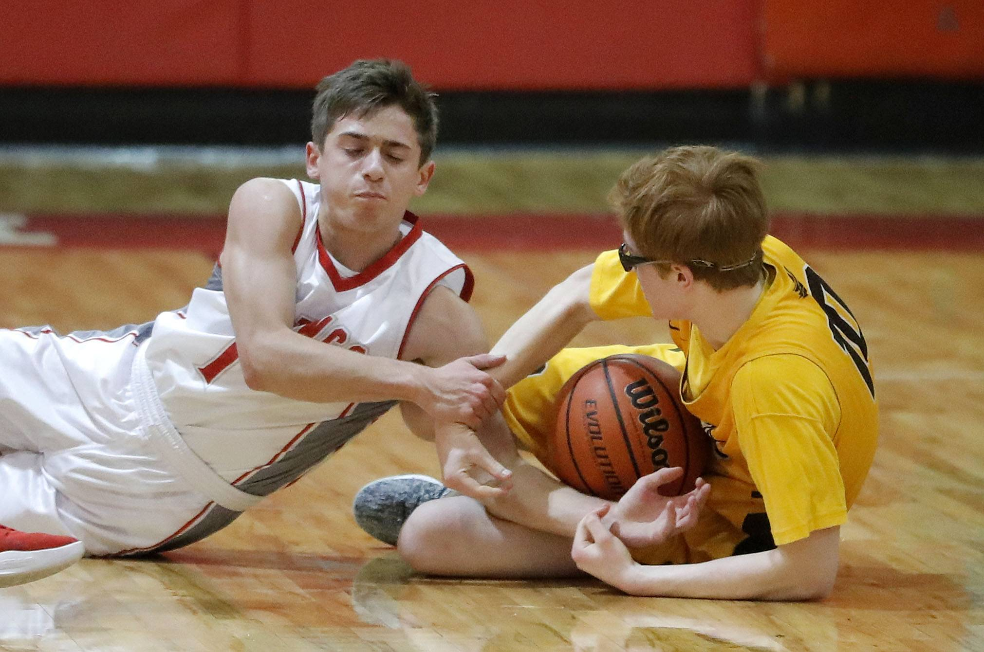 Mundelein's Sam Eddy, left, and Carmel's William Schott battle for a loose ball during their game Wednesday at Mundelein High School.
