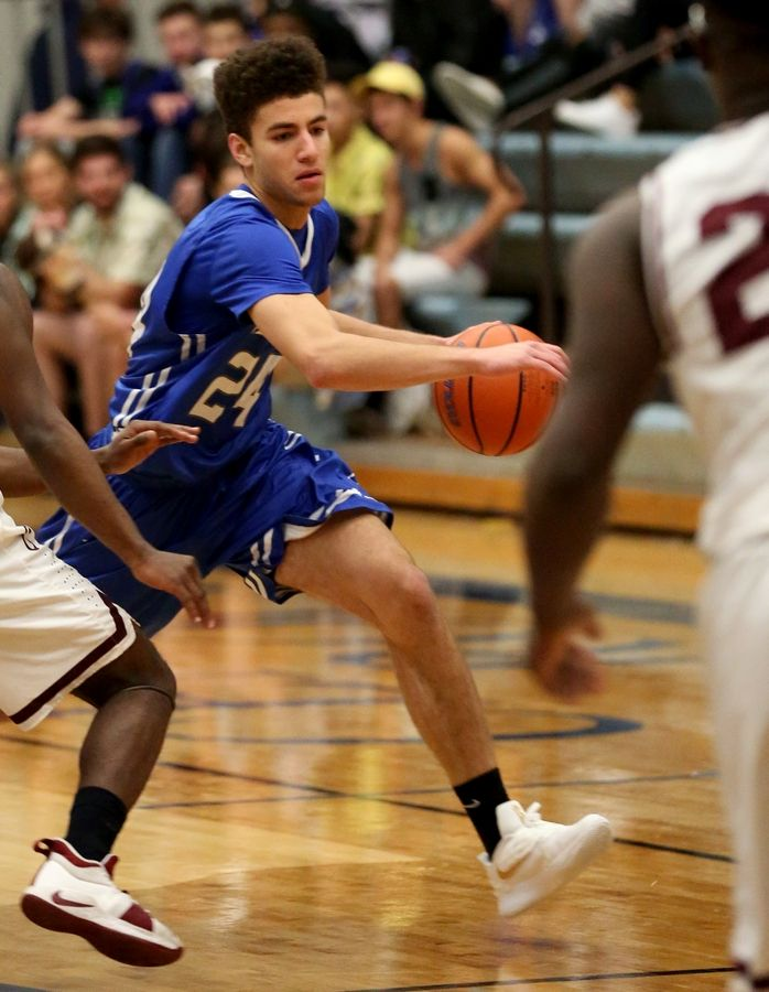 Burlington Central's Patrick Mayfield navigates through traffic against Elgin during MLK Classic varsity boys basketball tournament action Wednesday evening.