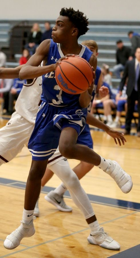 Burlington Central's Edward Wells saves the ball from going out of bounds against Elgin during MLK Classic varsity boys basketball tournament action Wednesday evening.