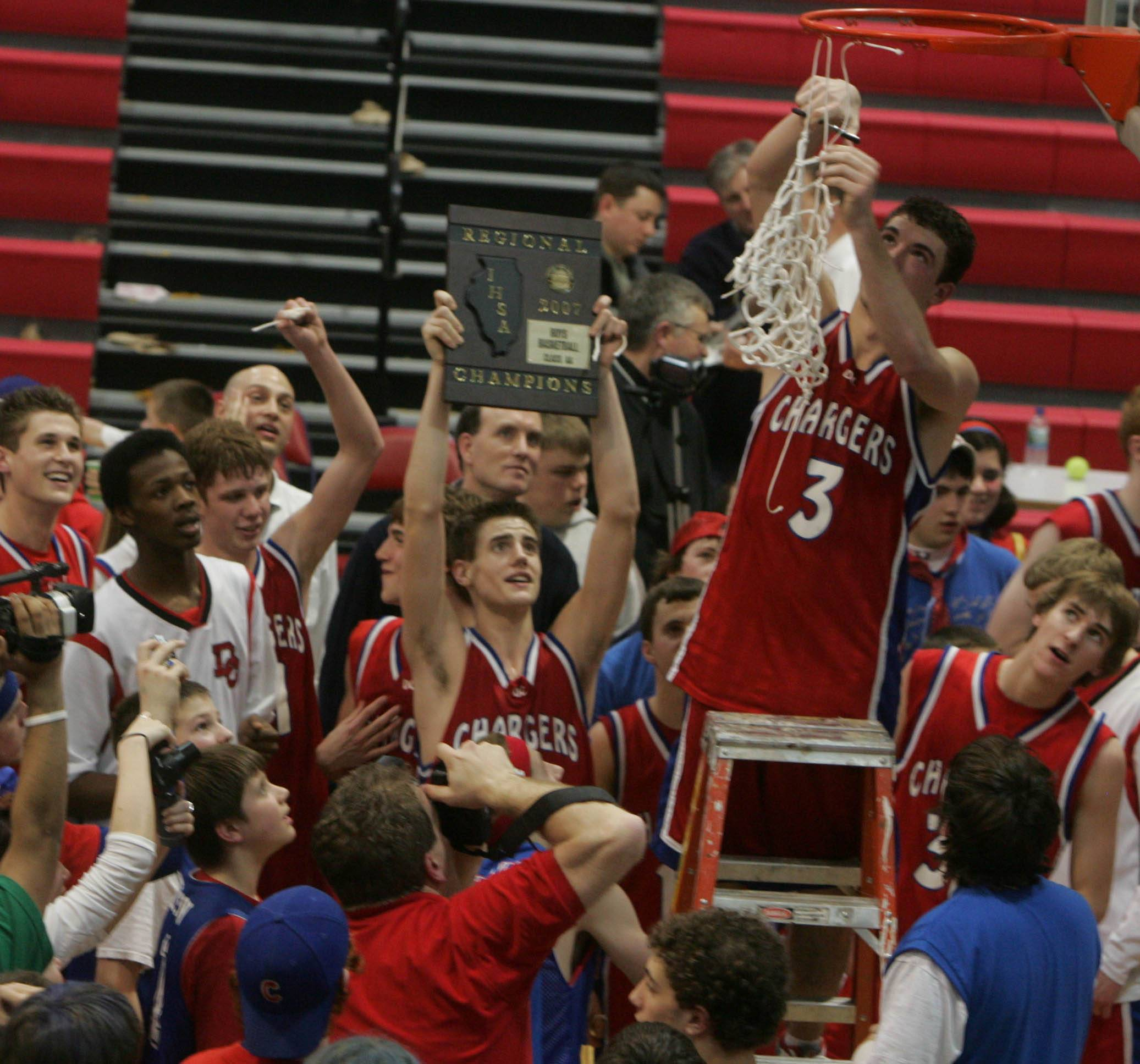 Dundee-Crown's Jeff Beck cuts down the net after a regional win in 2009. On Friday, the Chargers will celebrate the 10-year anniversary of that team that is the only one in school history to reach the state tournament.