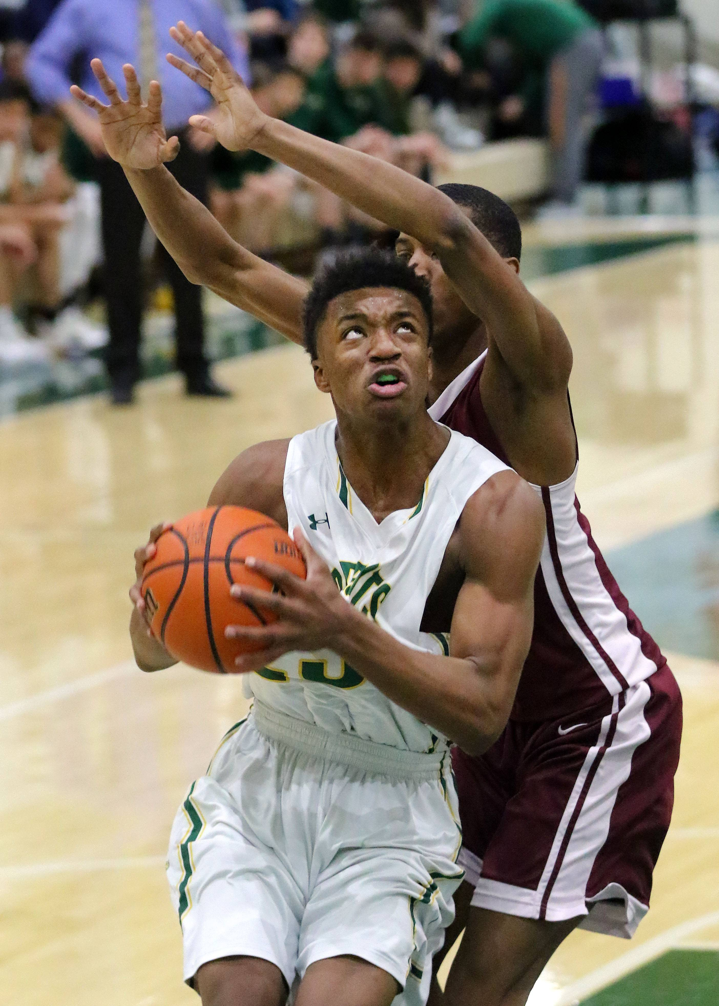 Stevenson's RJ Holmes, left, drives on Zion-Benton's Damontae Taylor during their game Friday in Lincolnshire.
