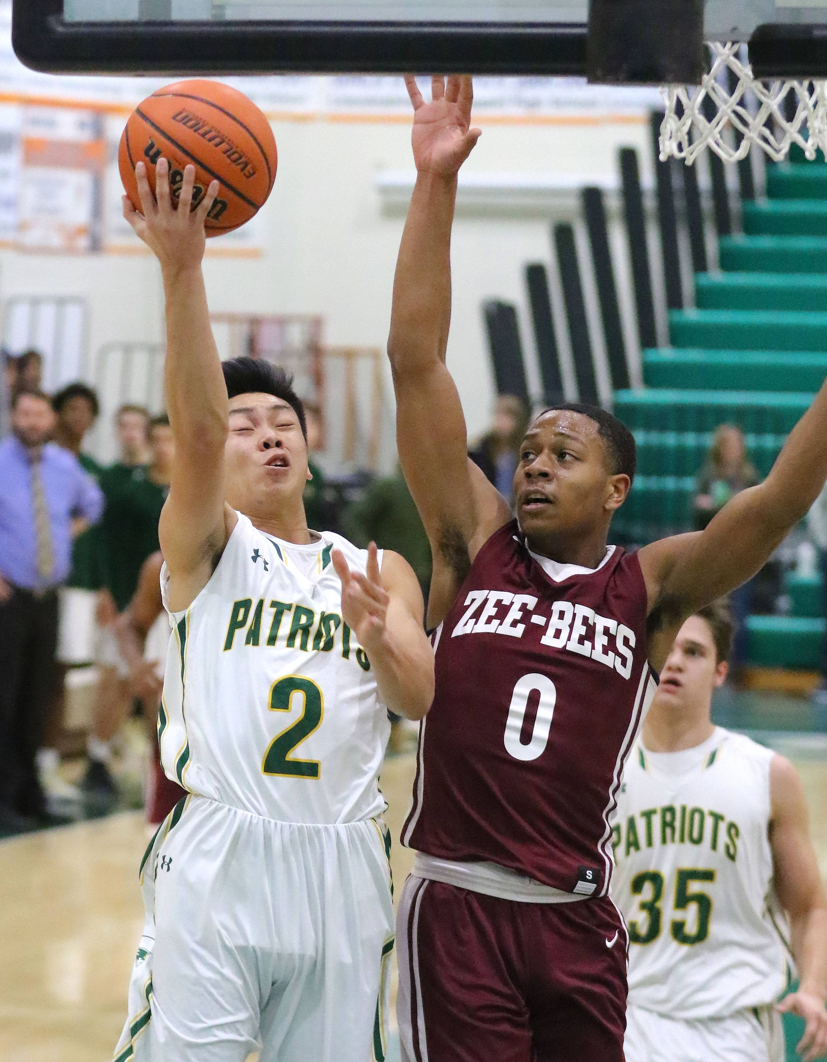 Stevenson's Luke Chieng (2) drives on Zion-Benton's Quentin Williams during their game Friday in Lincolnshire.
