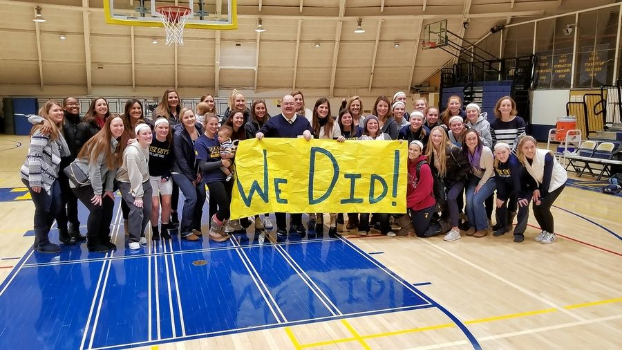Glenbrook South girls basketball coach Steve Weissenstein, middle, is retiring after this school year. The Prospect graduate was honored by several of his former players last Saturday when his Titans played Hersey.