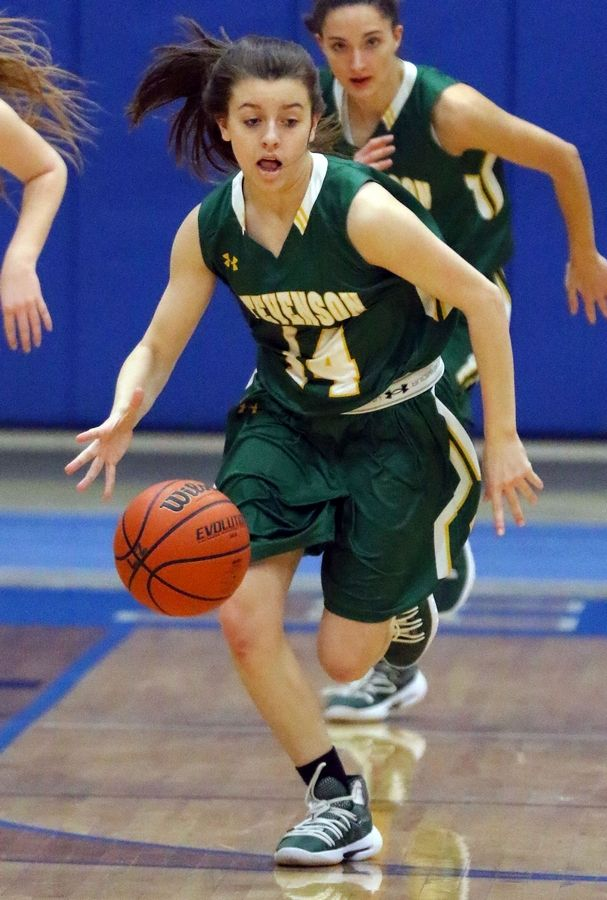 Stevenson's Ava Bardic drives the ball up court during the Patriots game Tuesday at Lake Zurich High School.