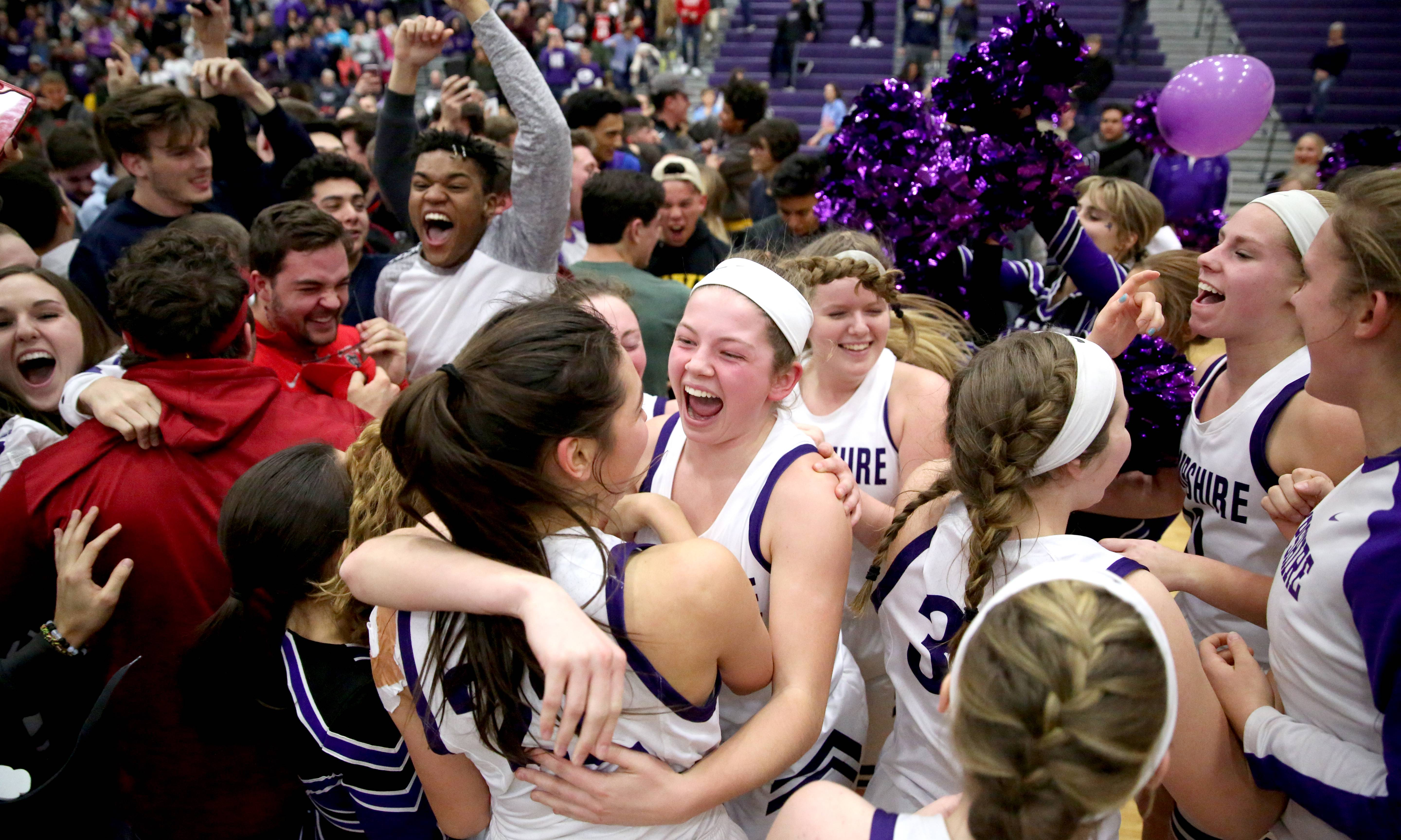 Hampshire's fans celebrate with players following win over Dundee-Crown at Hampshire Friday night. The Whip-Purs clinched a Fox Valley Conference title with the 43-38 victory.