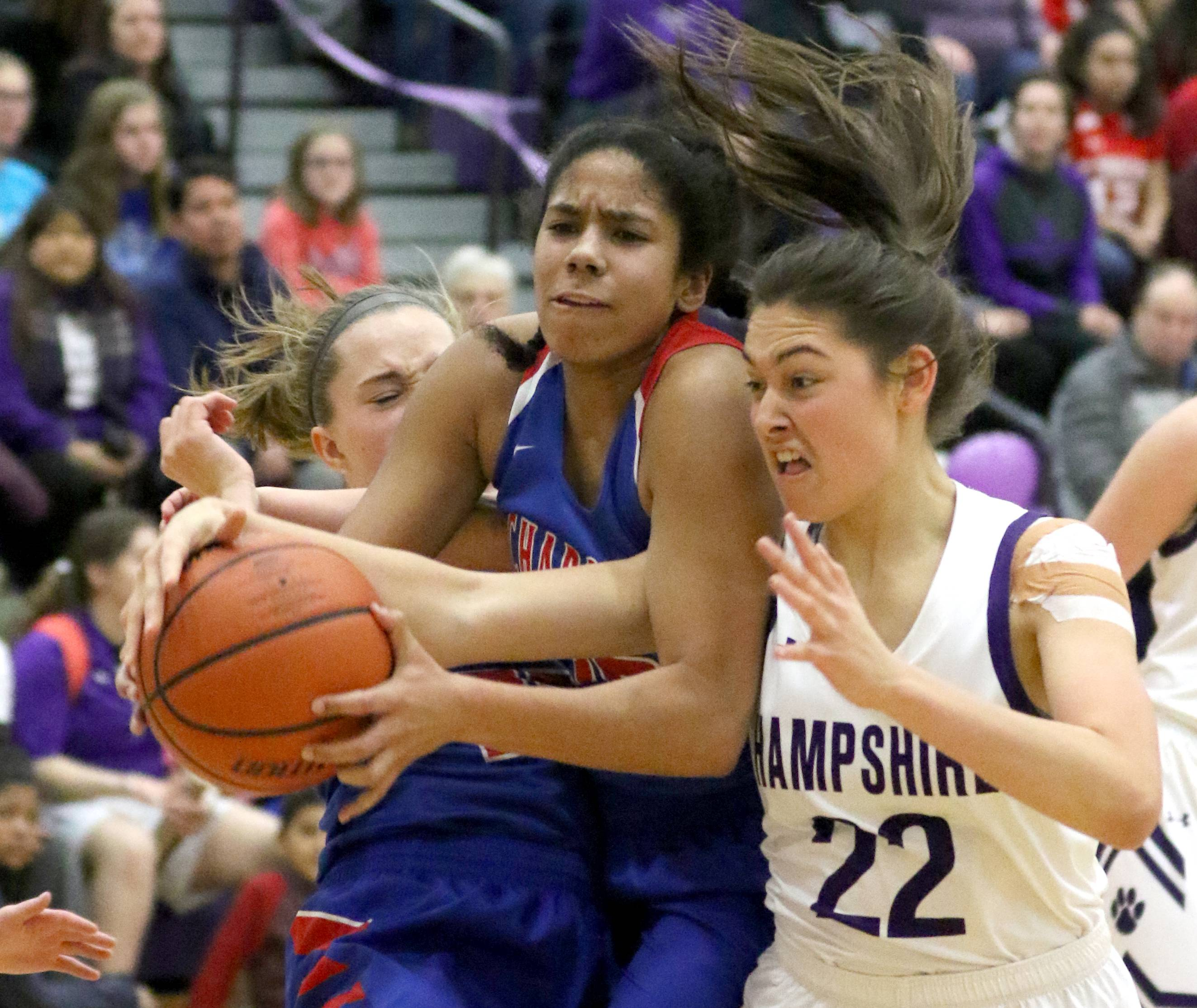 From left, Dundee-Crown's Kendall Kieltyka and Alyssa Crenshaw battle Hampshire's Veronica Walker for the ball during varsity girls basketball at Hampshire Friday night.