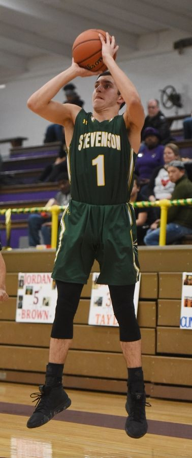 Stevenson's John Ittounas hits a shot from the corner during Tuesday's game in Waukegan.