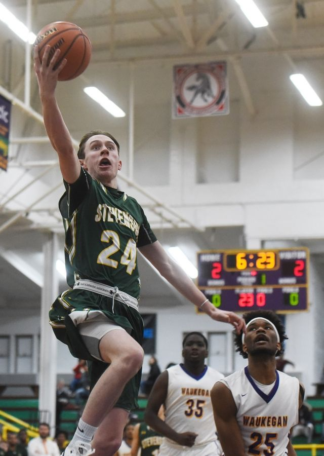 Stevenson's Matthew Ambrose drives to the basket for a layup during Tuesday's game.