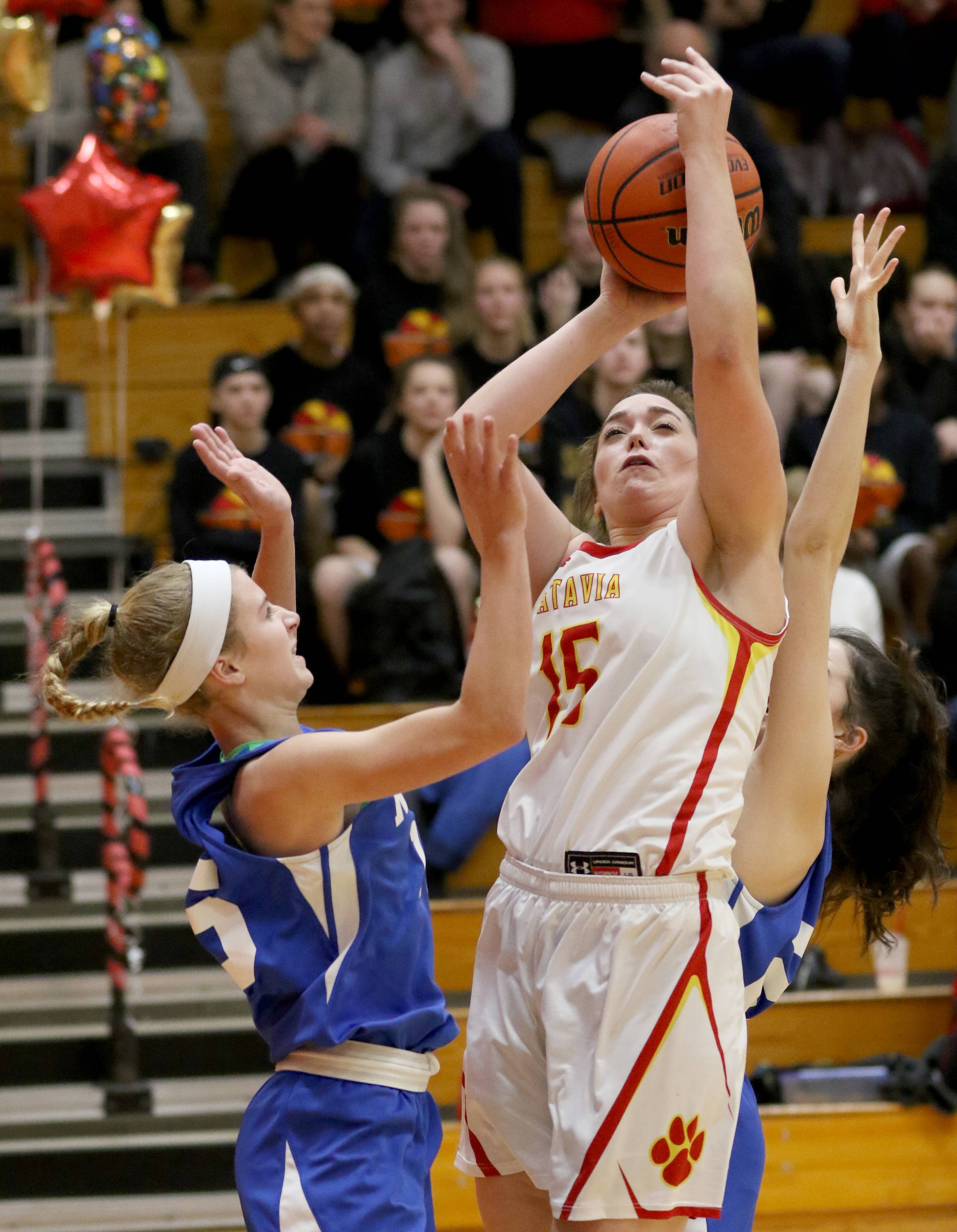 Batavia's Ava Sergio takes a shot against Wheaton North during varsity girls basketball at Batavia Thursday night.
