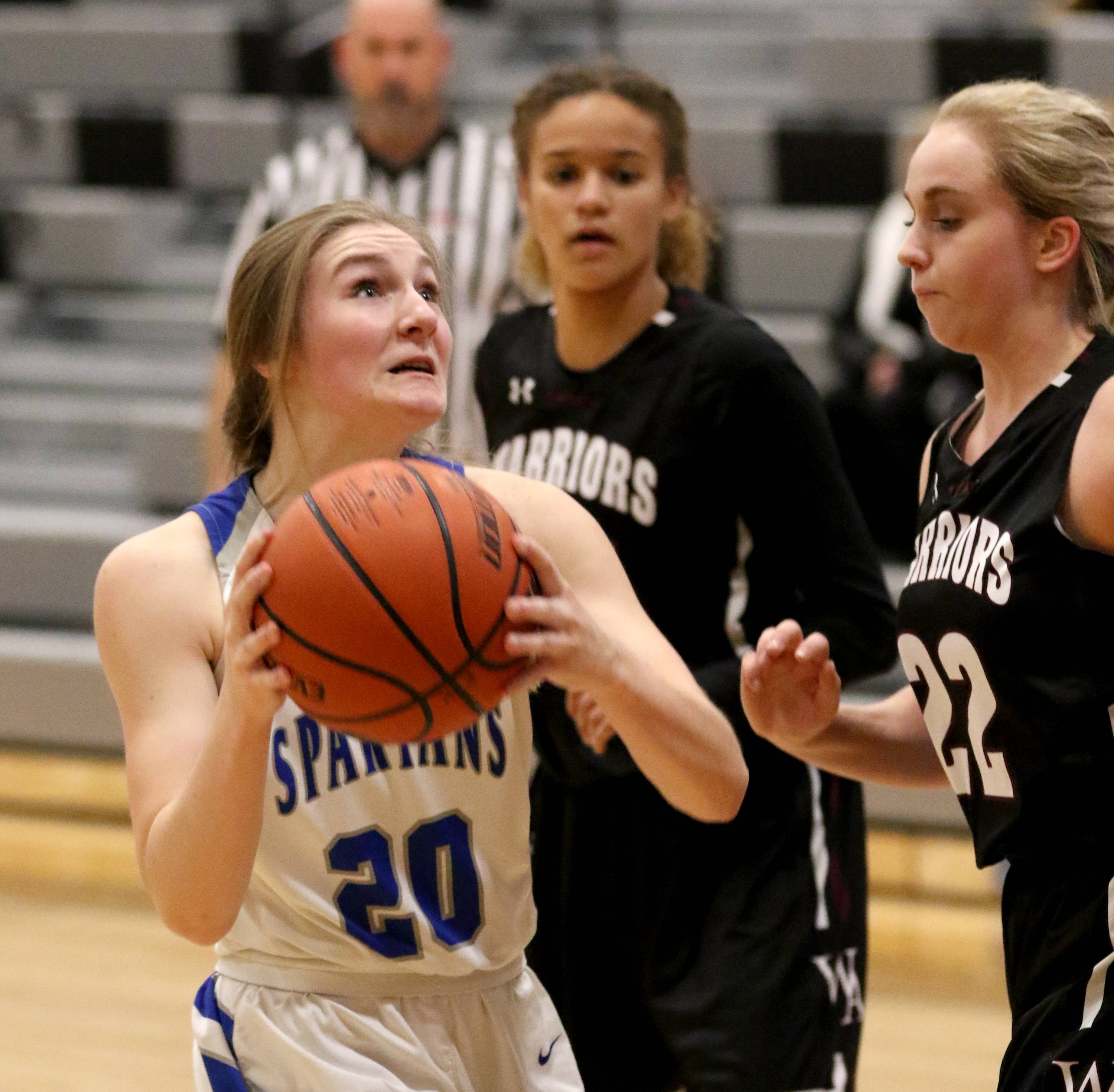 St. Francis' Megan Kruse looks to the hoop against Wheaton Academy during regional girls varsity basketball at Kaneland High School Monday night.