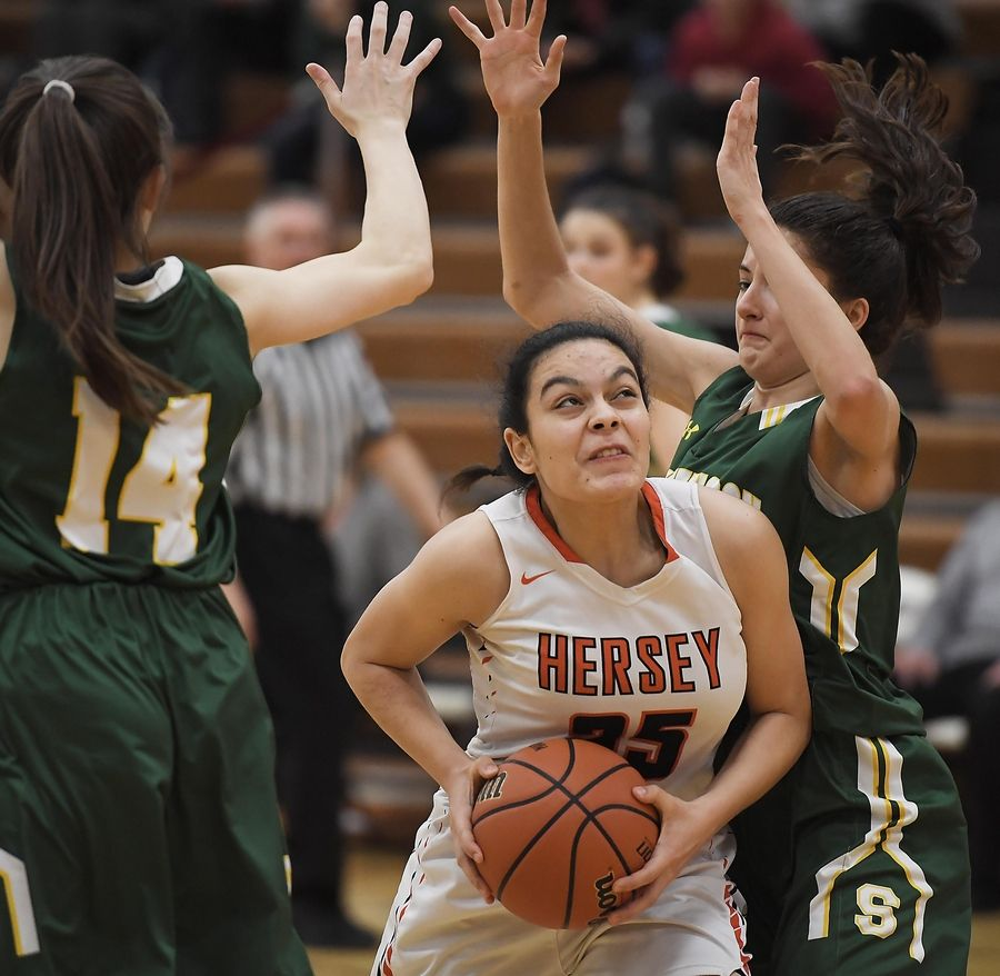 Hersey's Aya El-Fiky battles against Stevenson's Ava Bardic and Avery King in the Hersey girls basketball regional championship game Thursday in Arlington Heights.