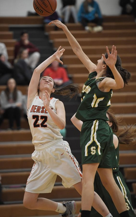 Stevenson's Avery King blocks a shot by Hersey's Maddie Jacobson in the Hersey girls basketball regional championship game Thursday in Arlington Heights.