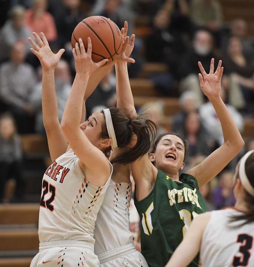 Hersey's Maddie Jacobson and teammate Aya El-Fiky battle with Stevenson's Avery King for the ball in the Hersey girls basketball regional championship game Thursday in Arlington Heights.