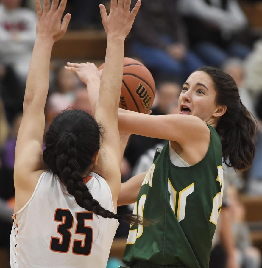 Stevenson's Avery King tries to shoot over Hersey's Aya El-Fiky in the Hersey girls basketball regional championship game Thursday in Arlington Heights.