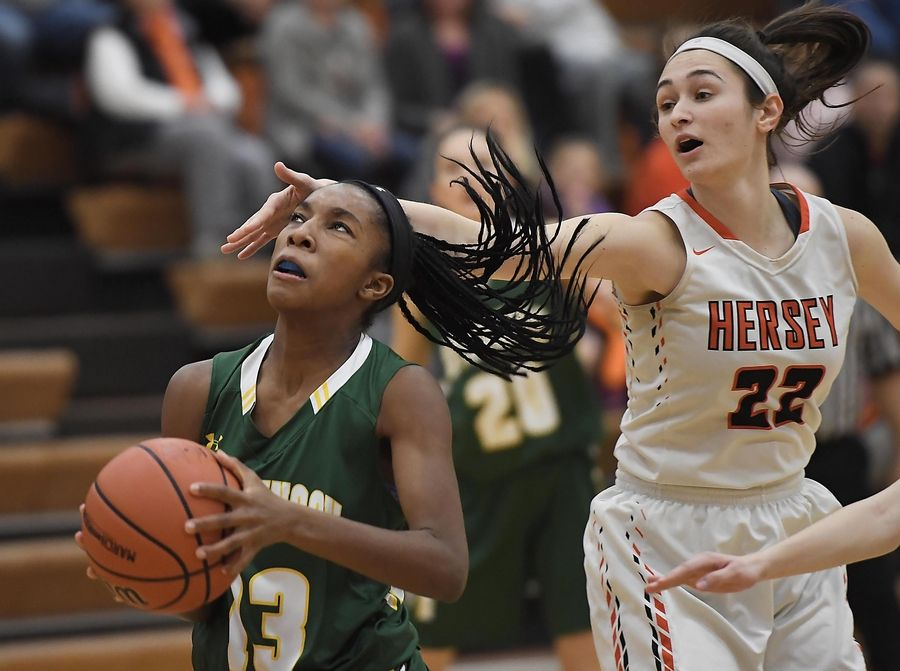 Hersey's Maddie Jacobson tries to slow down Stevenson's Simone Sawyer in the Hersey girls basketball regional championship game Thursday in Arlington Heights.