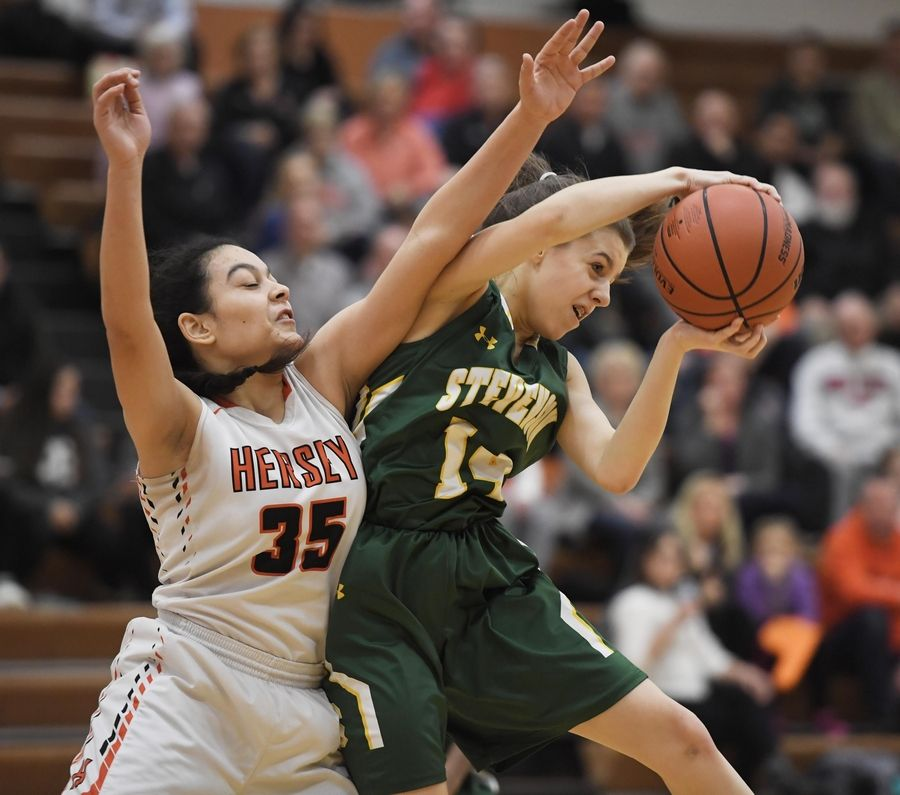 Stevenson's Ava Bardic pulls a rebound away from Hersey's Aya El-Fiky in the Hersey girls basketball regional championship game Thursday in Arlington Heights.