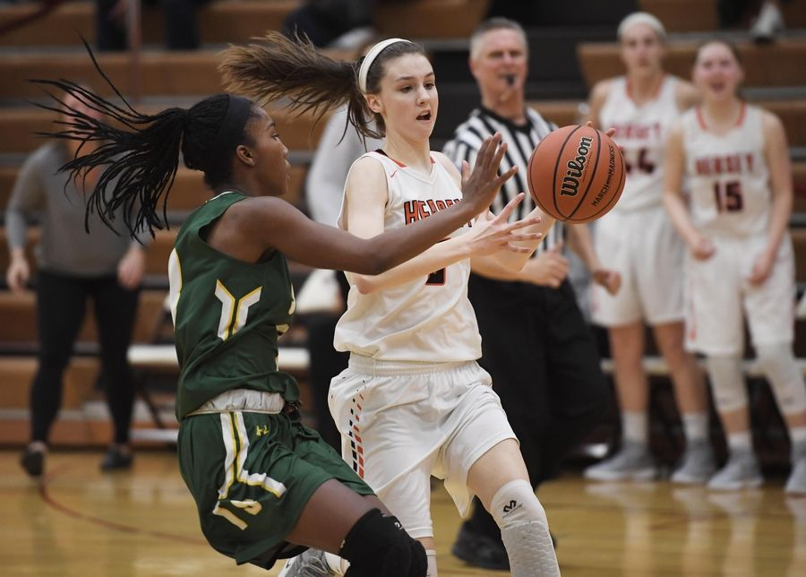 Hersey's Mary McGrath goes against Stevenson's Simone Sawyer in the Hersey girls basketball regional championship game Thursday in Arlington Heights.