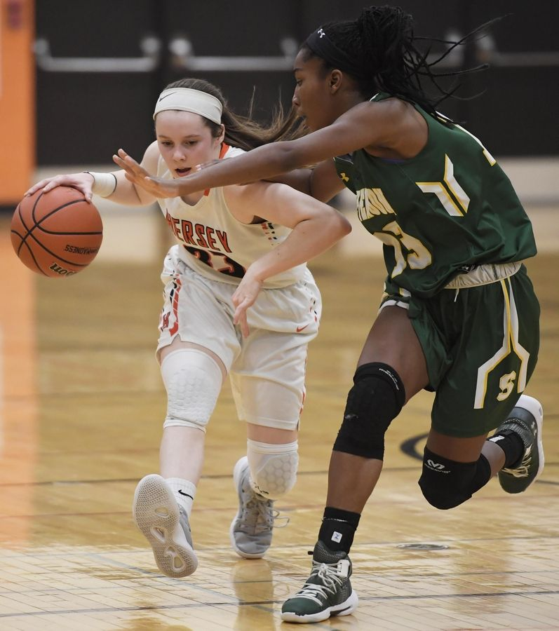 Hersey's Mary Kate Fahey tries to get past Stevenson's Simone Sawyer in the Hersey girls basketball regional championship game Thursday in Arlington Heights.