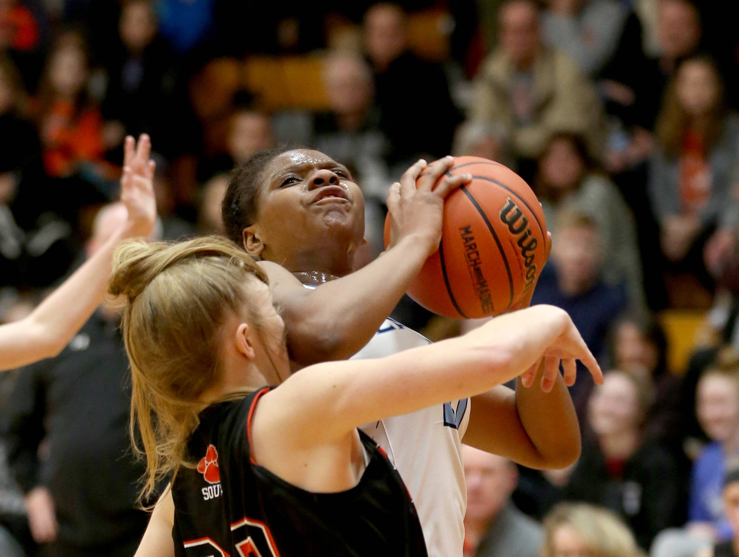 Lake Park's Darrione Rogers moves with the ball against Wheaton Warrenville South during sectional semifinal girls basketball action at Batavia Monday night.