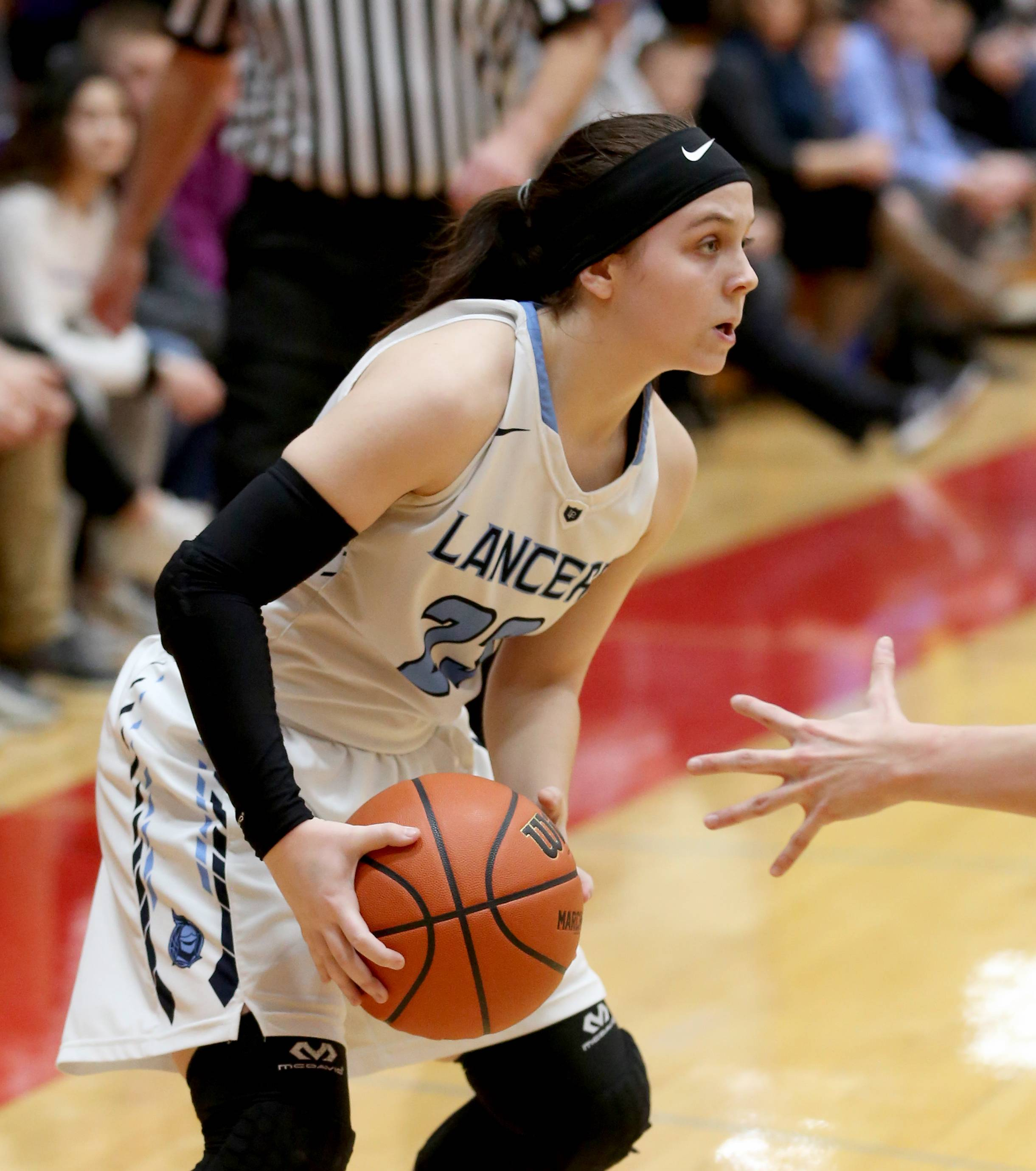 Lake Park's Casey Darre looks for an option against Wheaton Warrenville South during sectional semifinal girls basketball action at Batavia Monday night.