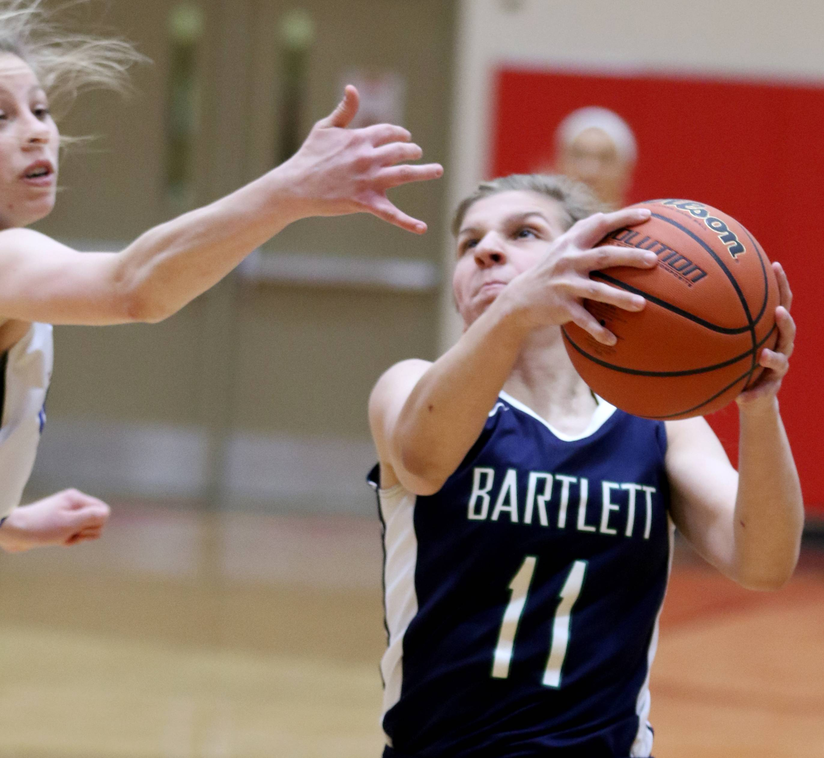 Bartlett's Alexis Sinclair goes to the hoop against Geneva during sectional semifinal girls basketball action at Batavia Monday night.