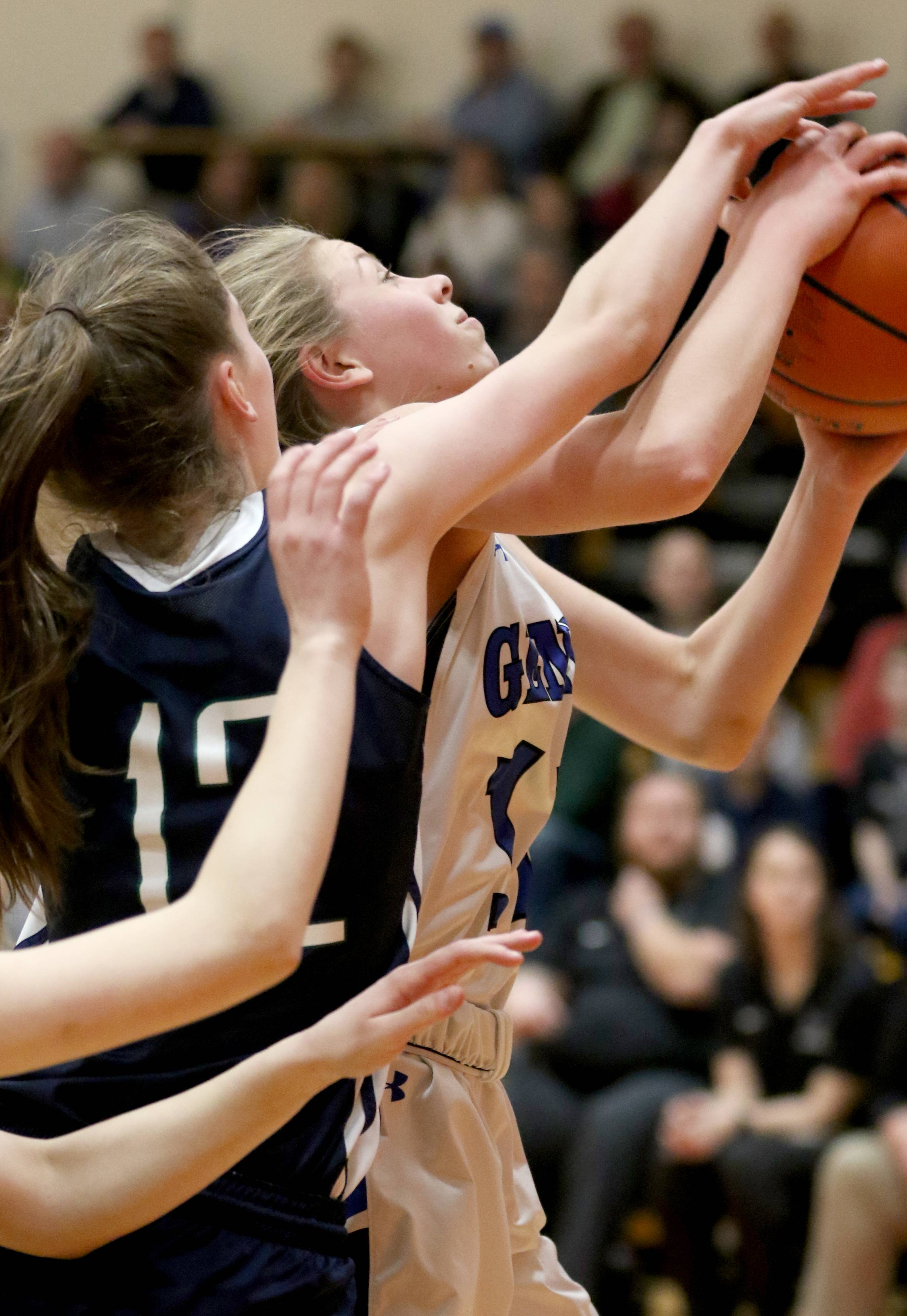 Geneva's Grace Hinchman goes to the hoop against Bartlett during sectional semifinal girls basketball action at Batavia Monday night.