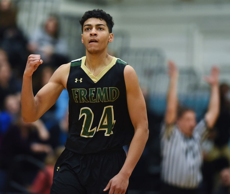 Fremd's Bryce Hopkins pumps his fist after hitting a 3-pointer to give his team a 75-72 lead over Prospect in double overtime during the Mid-Suburban League boys basketball championship game in Mount Prospect Wednesday.