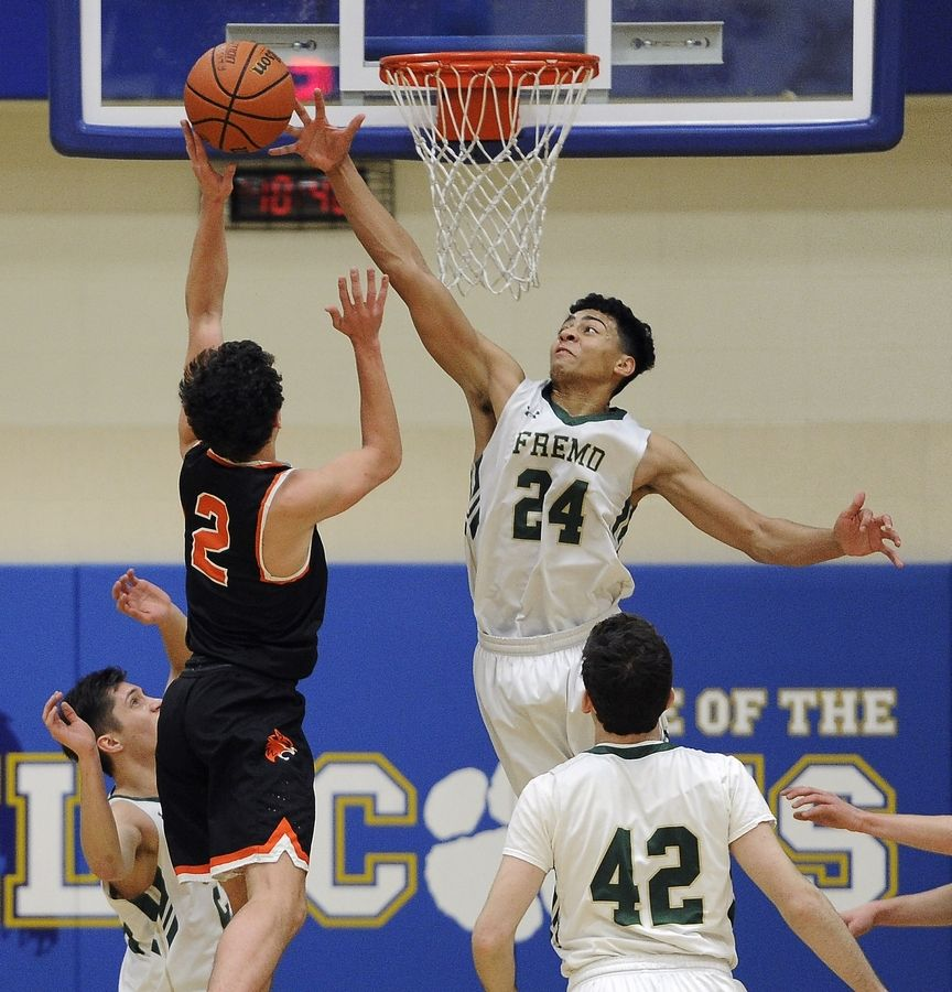 Fremd's Bryce Hopkins (24) blocks Libertyville's Brian Wilterdink from making his shot at the Wheeling Wildcat Hardwood Classic in December. Hopkins and the Vikings are the No. 2 seed behind Stevenson in the Class 4A Waukegan sectional.