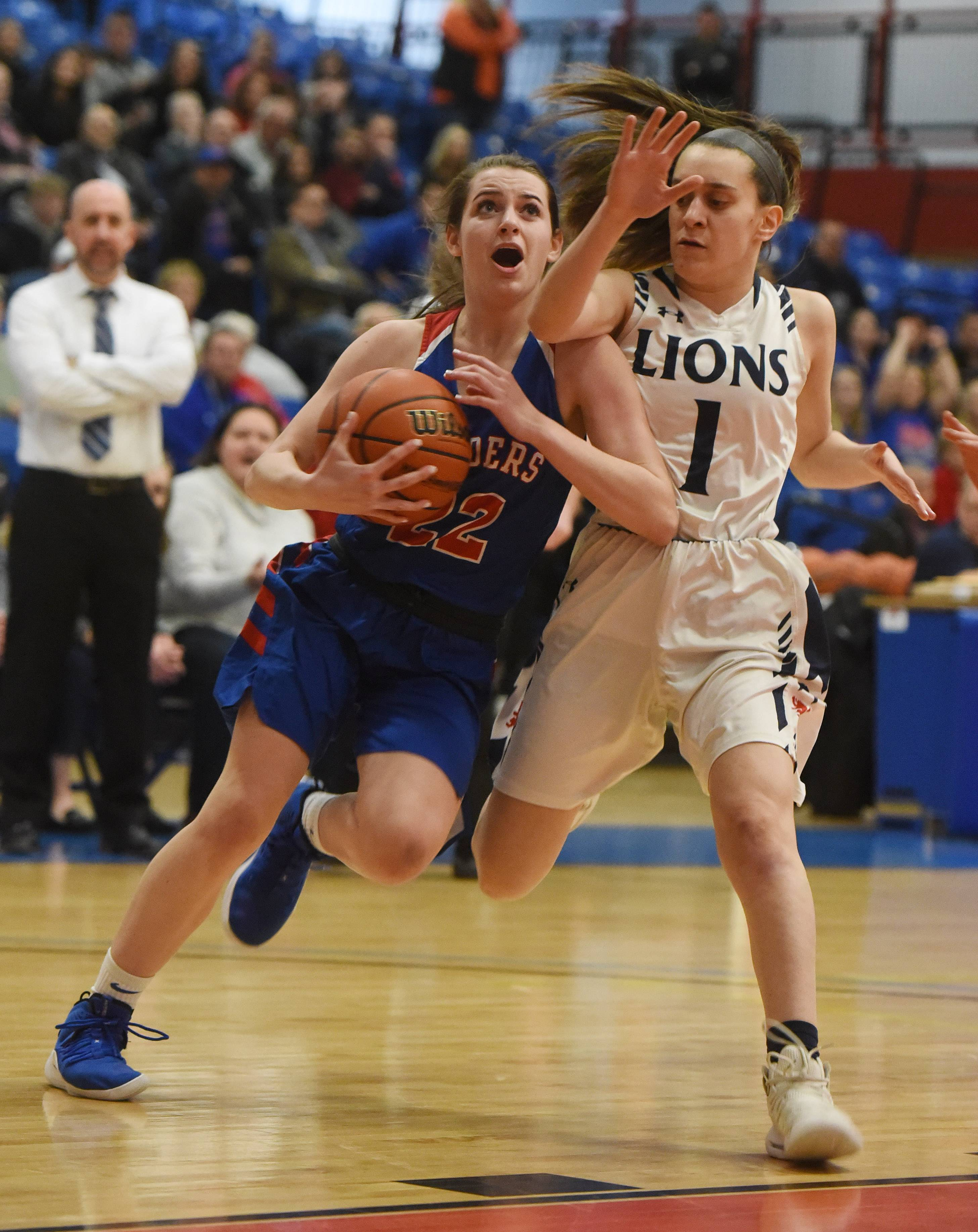 Glenbard South's Rocky LaPonte draws contact from St. Viator's Nora Ahram on her way to the basket during the Class 3A girls baskeball supersectional at Elgin Community College Monday.