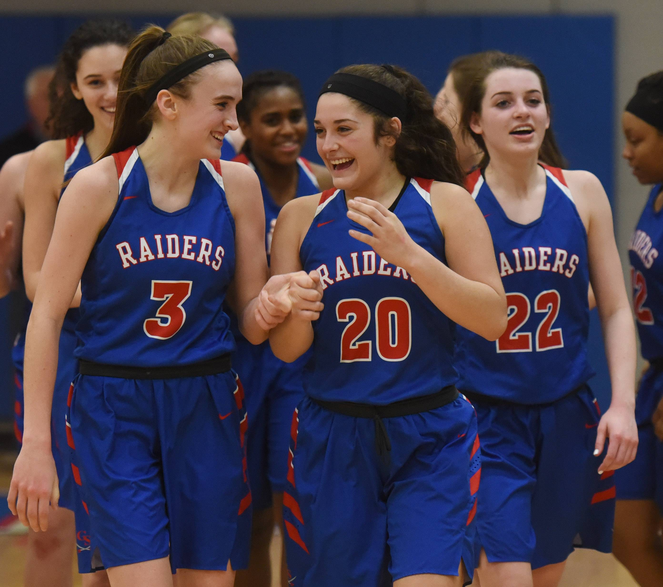 Glenbard South's Lauren Cohen, left, and Cat Karr celebrate together following their team's 34-24 victory over St. Viator during the Class 3A girls baskeball supersectional at Elgin Community College Monday.