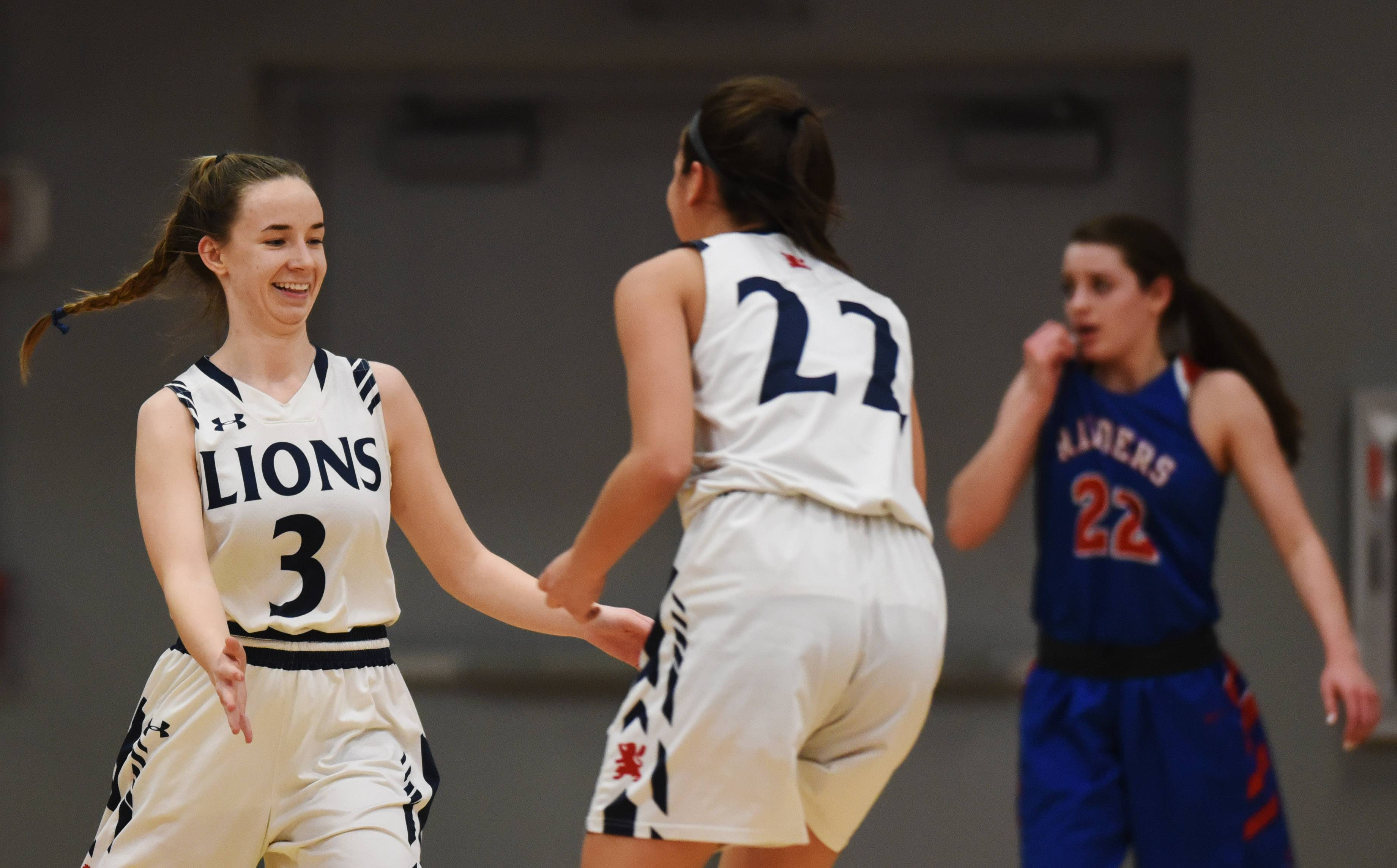 St. Viator's Natalie Krause, left, celebrates with teammate Joy Bergstrom after hitting a three-pointer to end the first quarter during the Class 3A girls baskeball supersectional against Glenbard South at Elgin Community College Monday.