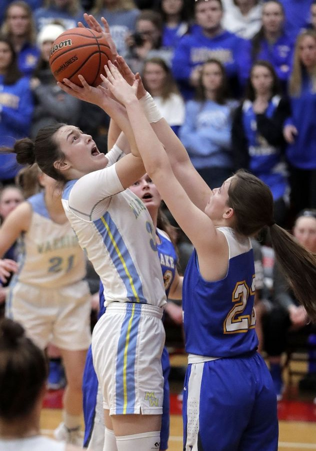 Maine West's Angela Dugalic, left, shoots over Lake Forest's Grace Tirzmalis during their supersectional game Monday night at Palatine High School.