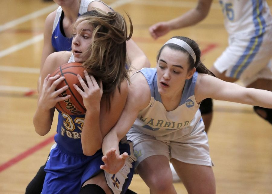 Lake Forest's Olivia Witte, left, and Maine West's Dylan Van Fleet battle for a rebound during their supersectional game Monday night at Palatine High School.