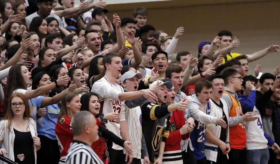 Maine West fans cheer during their supersectional game Monday night at Palatine High School.