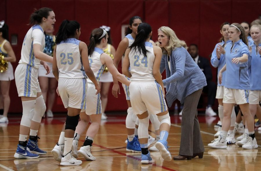 Maine West coach Kim de Maringy cheers on her team during their supersectional game Monday night at Palatine High School.