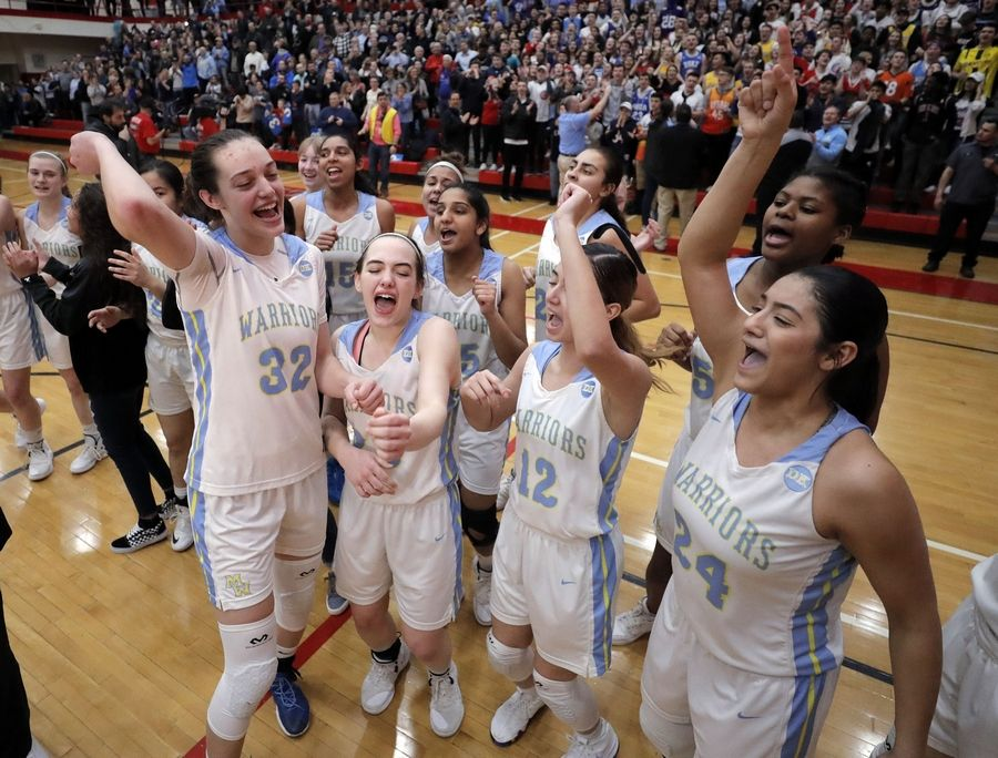 Maine West players celebrate after beating Lake Forest in the Supersectional Monday night at Palatine High School.