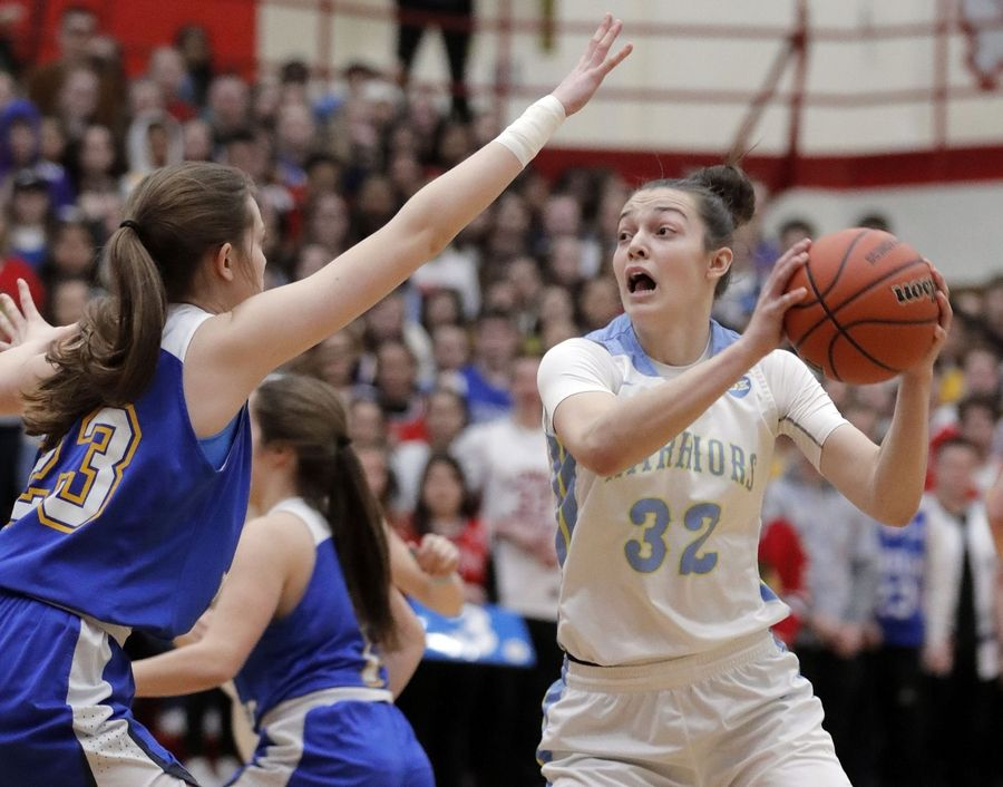 Maine West's Angela Dugalic (32) drives on Lake Forest's Grace Tirzmalis during their supersectional game Monday night at Palatine High School.