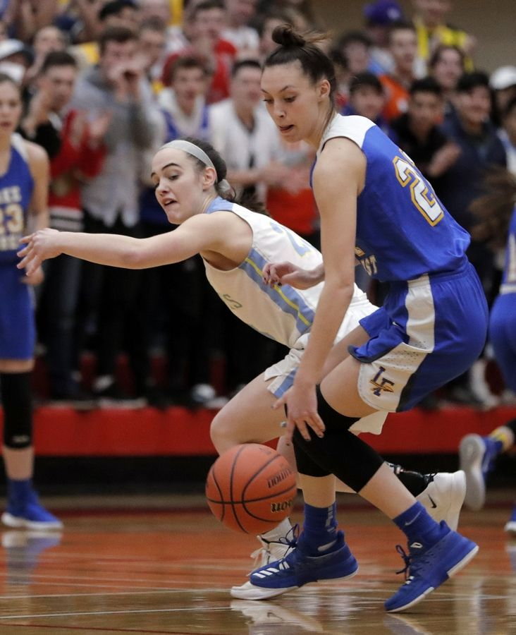 Maine West's Dylan Van Fleet, left, tries to steal one from Lake Forest's Halle Douglass during their supersectional game Monday night at Palatine High School.