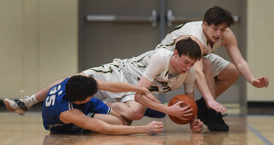 Stevenson's Matthew Ambrose, middle, and Jacob Tenner, right, go to the floor for a loose ball with Highland Park's Isaac Griswold during the Class 4A Lake Forest boys basketball regional semifinal Tuesday.