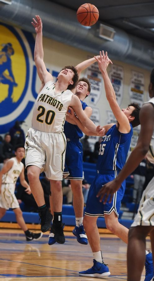 Stevenson's Jacob Tenner, left, battles for a rebound with Highland Park's Andrew Natinsky and Isaac Griswold, right, during the Class 4A Lake Forest boys basketball regional semifinal Tuesday.