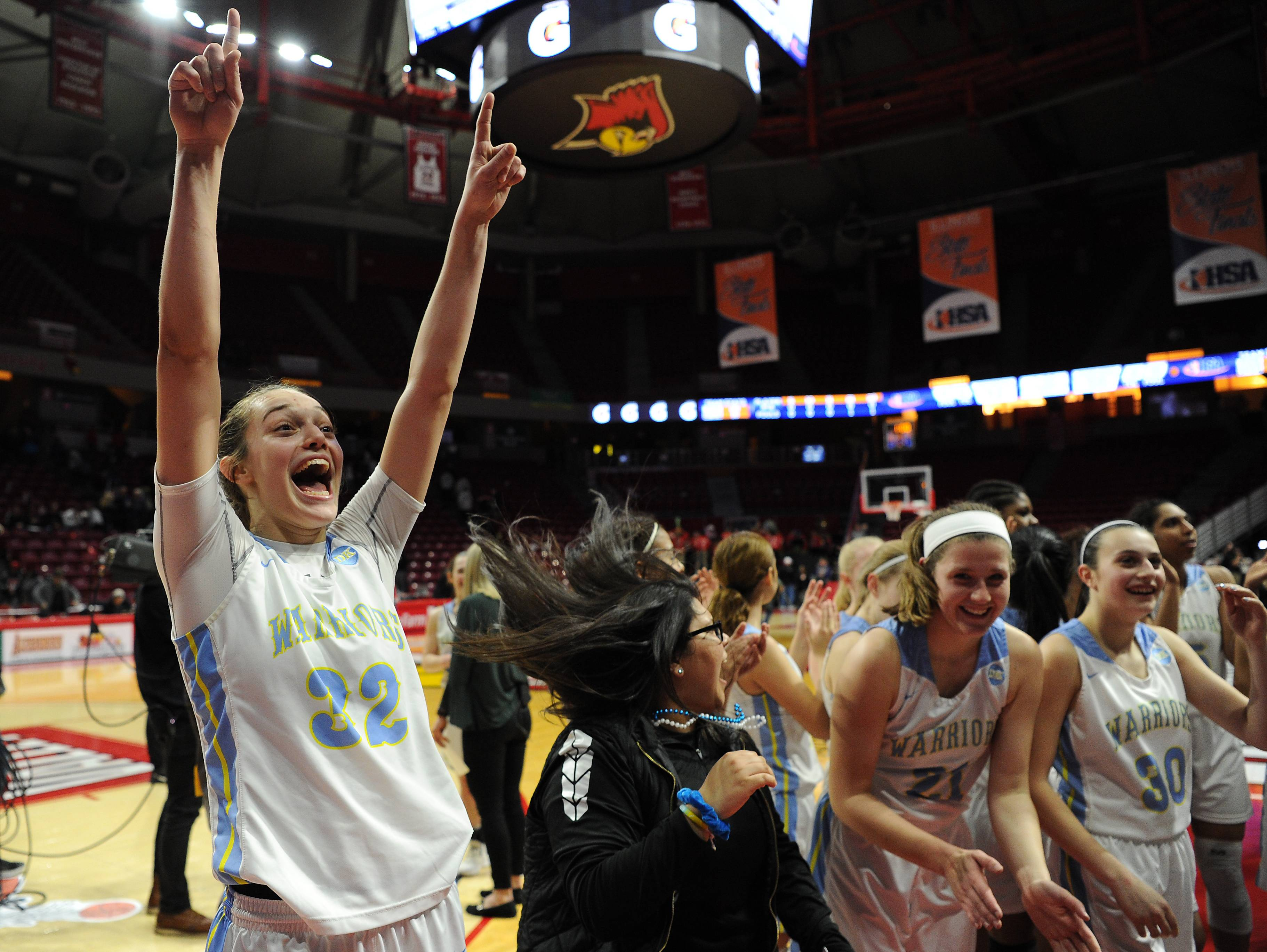 Maine West's Angela Dugalic celebrates with her teammates as she turns towards her fans after they win over Hononegah and head to the finals against Mother McAuley in the IHSA girls state basketball Class 4A semifinals at Normal on Friday.