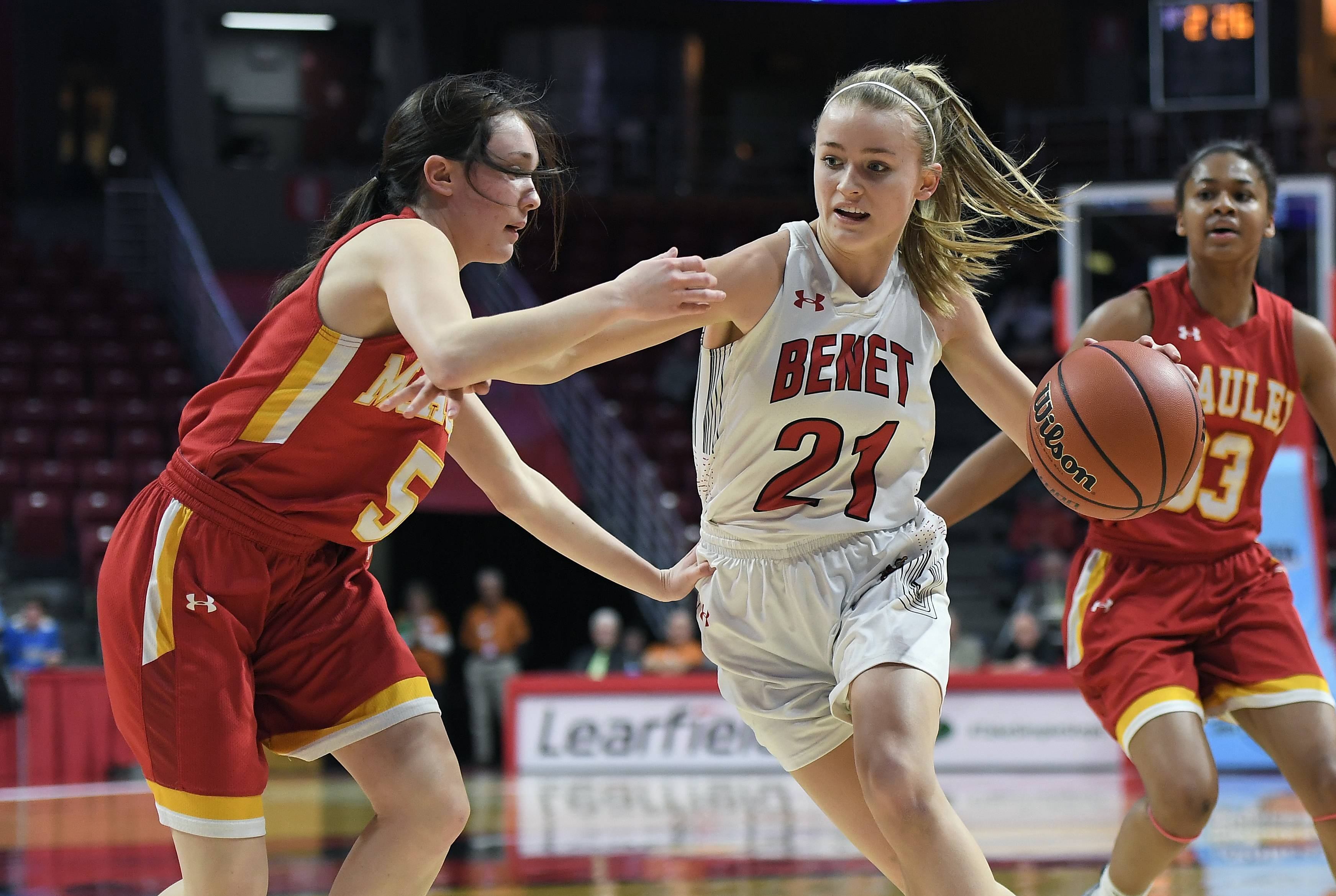 Benet Academy's Clara Prasse fights to drive around Mother McAuley's Nikki Murphy in the first quarter during IHSA girls state basketball Class 4A semifinals at Normal on Friday.