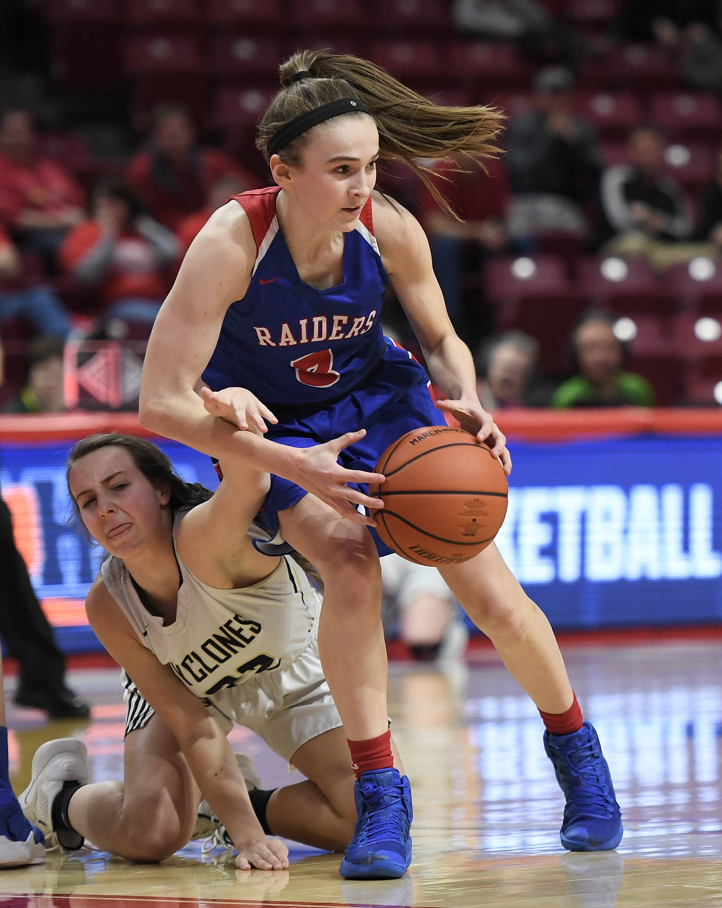 Glenbard South's Lauren Cohen gets tangled up with Sacred Heart-Griffin's defense and passes off the ball to her teammate during the fourth quarter of play during IHSA girls state basketball Class 3A semifinals at Normal on Friday.
