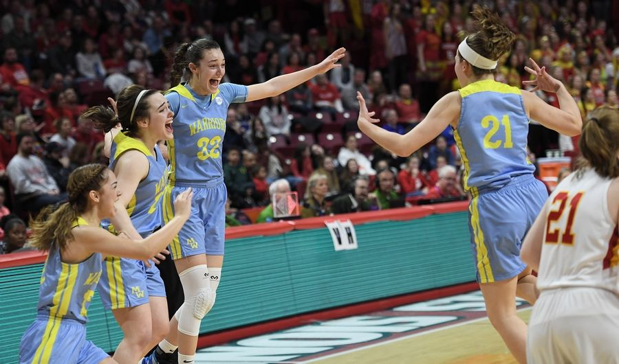 Maine West's Angela Dugalic celebrates with her teammates including Ellie Centella after they beat Mother McAuley 58-46 in the IHSA girls state basketball Class 4A finals at Normal on Friday.