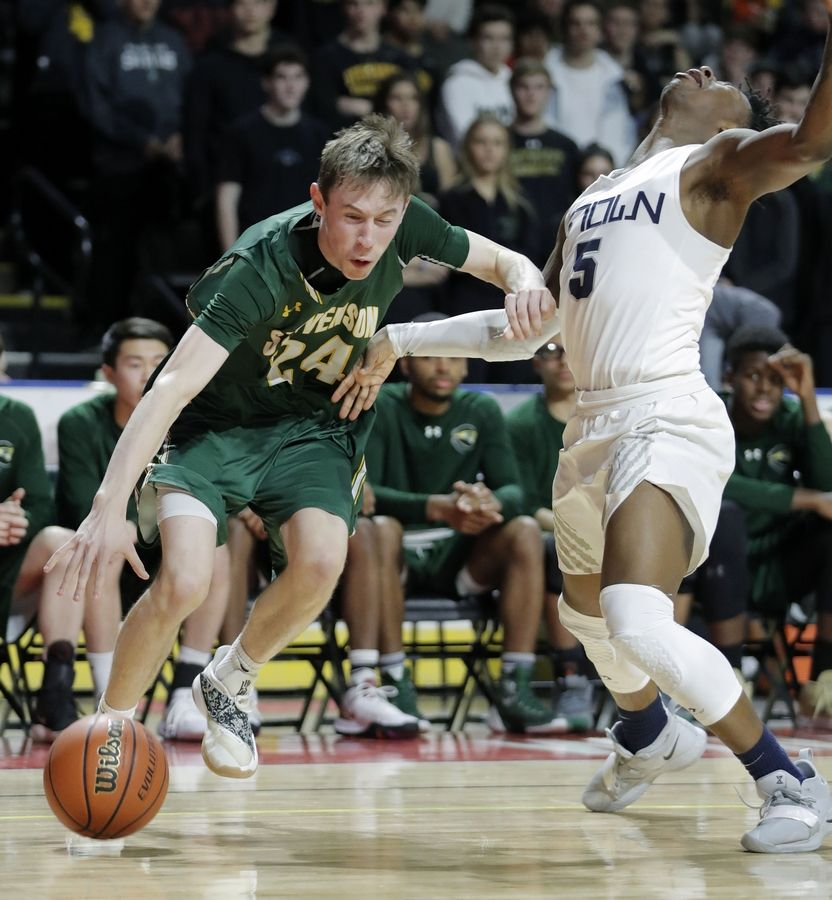 Stevenson's Matthew Ambrose, left, drives on Evanston's Lance Jones during the Class 4A boys basketball supersectional Tuesday night at the Sears Centre in Hoffman Estates.