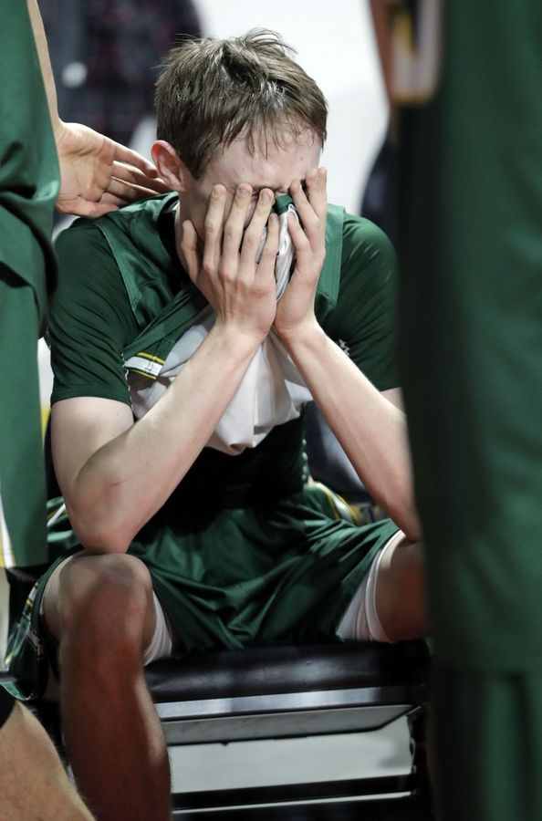 Stevenson's Matthew Ambrose reacts after losing to Evanston in overtime during the Class 4A boys basketball supersectional Tuesday night at the Sears Centre in Hoffman Estates.