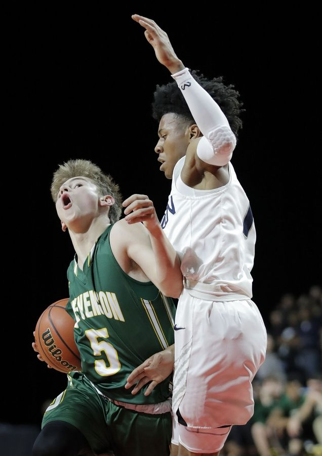 Stevenson's Evan Ambrose, left, drives on Evanston's Jaheim Holden during the Class 4A boys basketball supersectional Tuesday night at the Sears Centre in Hoffman Estates.