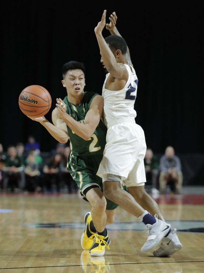 Stevenson's Luke Chieng drives on Evanston's Jalen Christian during the Class 4A boys basketball supersectional Tuesday night at the Sears Centre in Hoffman Estates.