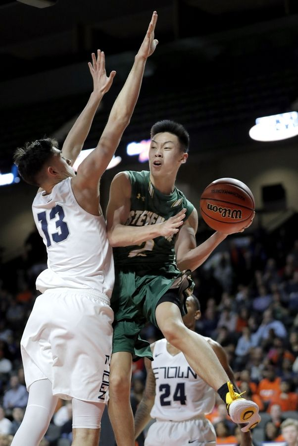Stevenson's Luke Chieng, right, drives on Evanston's Louis Lesmond during the Class 4A boys basketball supersectional Tuesday night at the Sears Centre in Hoffman Estates.